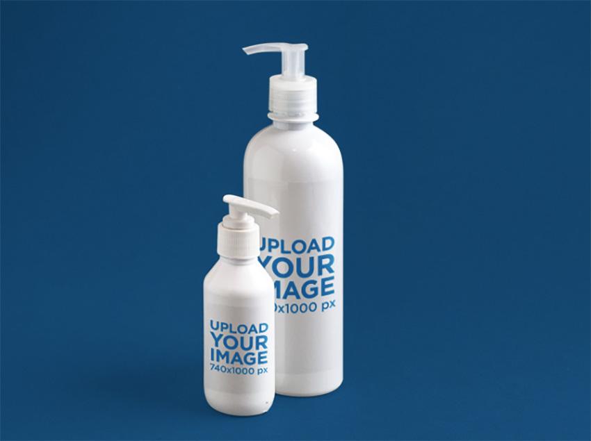 Label Mockup of a Set of Soap Bottles Over a Flat Backdrop